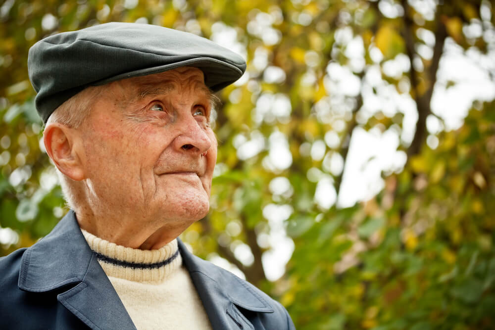 Senior man in hat outside